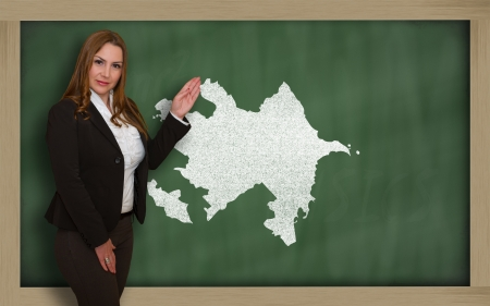 azerbaijanian: Successful, beautiful and confident young woman showing map of azerbaijan on blackboard for presentation, marketing research and tourist advertising Stock Photo