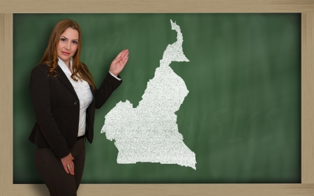 Successful, beautiful and confident young woman showing map of cameroon on blackboard for presentation, marketing research and tourist advertising Stock Photo - 18631665