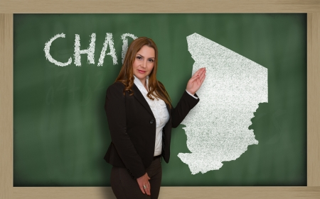 Successful, beautiful and confident young woman showing map of chad on blackboard for presentation, marketing research and tourist advertising photo