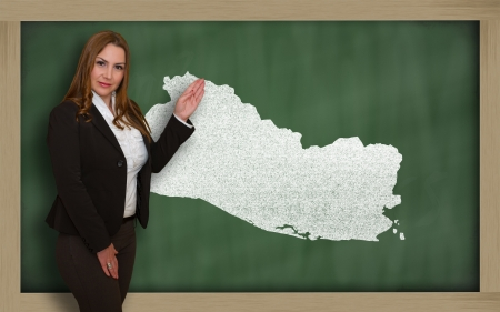 el salvadoran: Successful, beautiful and confident young woman showing map of el salvador on blackboard for presentation, marketing research and tourist advertising
