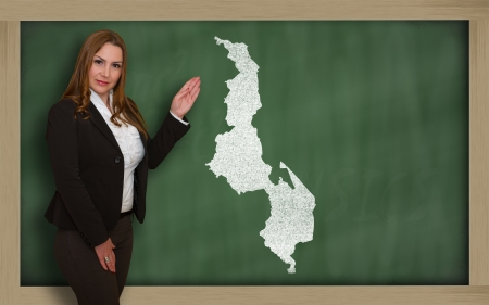 Successful, beautiful and confident young woman showing map of malawi on blackboard for presentation, marketing research and tourist advertising photo