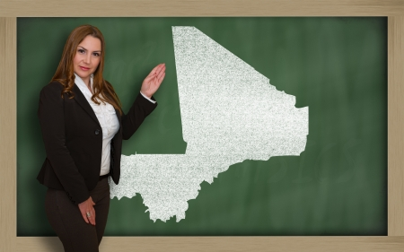 Successful, beautiful and confident young woman showing map of mali on blackboard for presentation, marketing research and tourist advertising photo