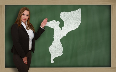 Successful, beautiful and confident young woman showing map of mozambique on blackboard for presentation, marketing research and tourist advertising photo