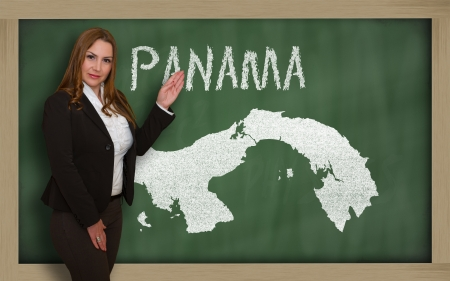 panamanian: Successful, beautiful and confident young woman showing map of panama on blackboard for presentation, marketing research and tourist advertising