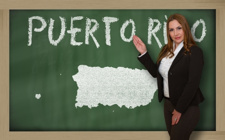 puertorico: Successful, beautiful and confident young woman showing map of puerto rico on blackboard for presentation, marketing research and tourist advertising Stock Photo