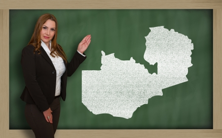 Successful, beautiful and confident young woman showing map of zambia on blackboard for presentation, marketing research and tourist advertising photo