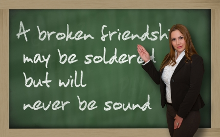 soldered: Successful, beautiful and confident woman showing A broken friendship may be soldered but will on blackboard