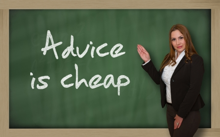 advising: Successful, beautiful and confident woman showing Advice is cheap on blackboard Stock Photo