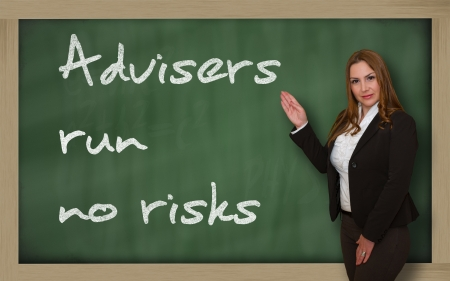 wriiting: Successful, beautiful and confident woman showing advisers run no risks on blackboard