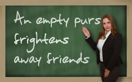 wriiting: Successful, beautiful and confident woman showing An empty purse frightens away friends on blackboard