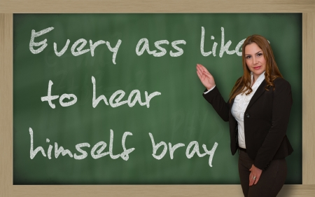 wriiting: Successful, beautiful and confident woman showing Every ass likes to hear himself bray on blackboard