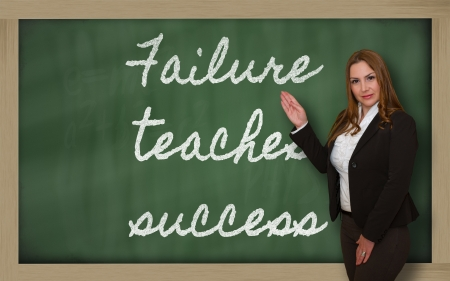 teaches: Successful, beautiful and confident woman showing Failure teaches success on blackboard