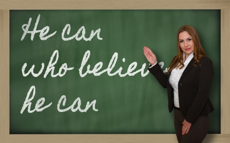he: Successful, beautiful and confident woman showing He can who believes he can on blackboard Stock Photo