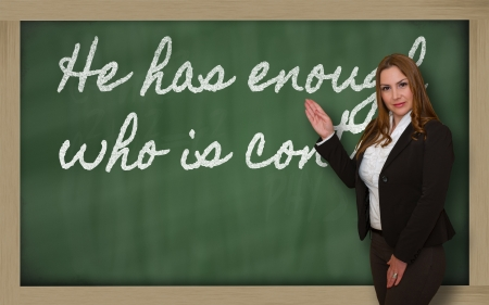 Successful, beautiful and confident woman showing He has enough who is content on blackboard Stock Photo - 18660213