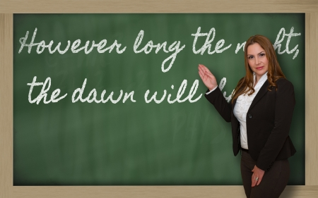 long night: Successful, beautiful and confident woman showing However long the night, the dawn will  break on blackboard