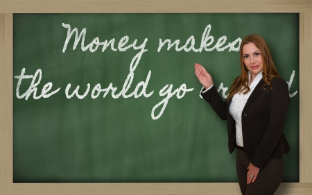 Successful, beautiful and confident woman showing Money makes the world go around on blackboard Stock Photo - 18660142