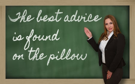 cushions: Successful, beautiful and confident woman showing The best advice is found on the pillow on blackboard