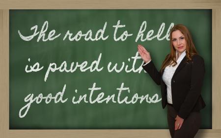 地獄への道を示す成功、美しい、自信を持って女性黒板善意で舗装されています。 写真素材