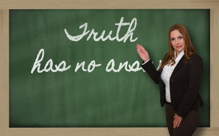 has: Successful, beautiful and confident woman showing Truth has no answer on blackboard Stock Photo