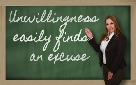 excuse: Successful, beautiful and confident woman showing Unwillingness easily finds an excuse on blackboard