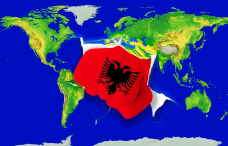 powerfull: Fist in color national flag of albania punching world map as symbol of export, economic growth, power and success