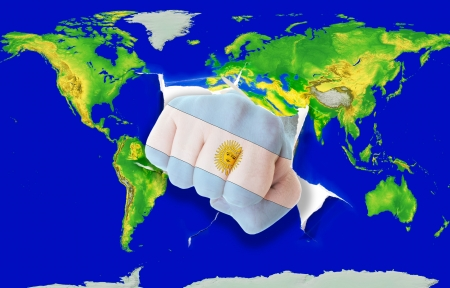powerfull: Fist in color national flag of argentina punching world map as symbol of export, economic growth, power and success