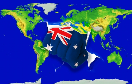 powerfull: Fist in color national flag of australia punching world map as symbol of export, economic growth, power and success