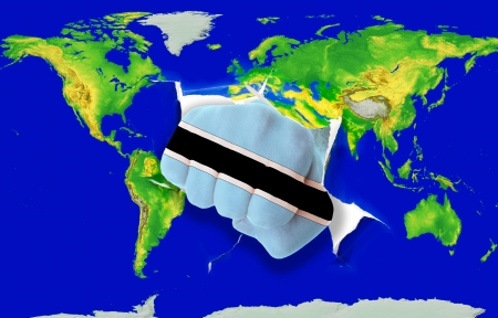 powerfull: Fist in color national flag of botswana punching world map as symbol of export, economic growth, power and success Stock Photo
