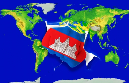 Fist in color national flag of cambodia punching world map as symbol of export, economic growth, power and success photo