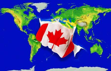 powerfull: Fist in color national flag of canada punching world map as symbol of export, economic growth, power and success