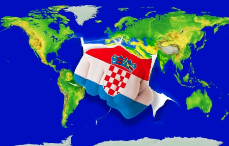 powerfull: Fist in color national flag of croatia punching world map as symbol of export, economic growth, power and success Stock Photo
