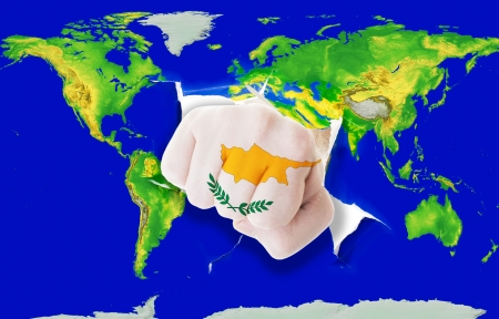 powerfull: Fist in color national flag of cyprus punching world map as symbol of export, economic growth, power and success Stock Photo