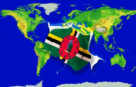 Fist in color national flag of dominica punching world map as symbol of export, economic growth, power and success photo