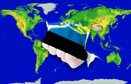 powerfull: Fist in color national flag of estonia punching world map as symbol of export, economic growth, power and success Stock Photo