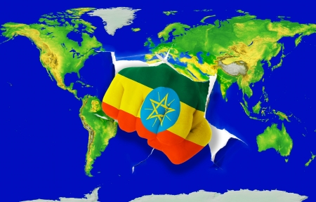 powerfull: Fist in color national flag of ethiopia punching world map as symbol of export, economic growth, power and success Stock Photo