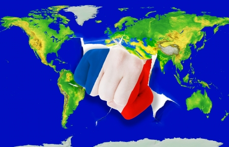 Fist in color national flag of france punching world map as symbol of export, economic growth, power and success photo