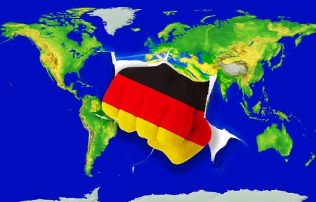 powerfull: Fist in color national flag of germany punching world map as symbol of export, economic growth, power and success