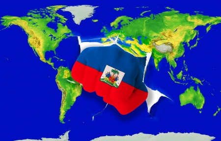 powerfull: Fist in color national flag of haiti punching world map as symbol of export, economic growth, power and success Stock Photo