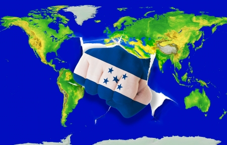powerfull: Fist in color national flag of honduras punching world map as symbol of export, economic growth, power and success