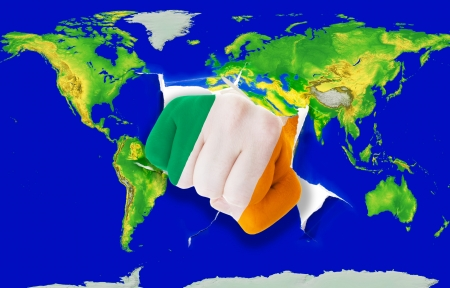 irish pride: Fist in color national flag of ireland punching world map as symbol of export, economic growth, power and success