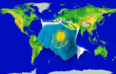 powerfull: Fist in color national flag of kazakhstan punching world map as symbol of export, economic growth, power and success Stock Photo