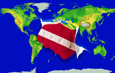 powerfull: Fist in color national flag of latvia punching world map as symbol of export, economic growth, power and success