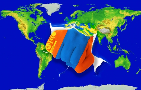 powerfull: Fist in color national flag of mongolia punching world map as symbol of export, economic growth, power and success