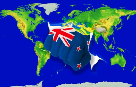 powerfull: Fist in color national flag of new zealand punching world map as symbol of export, economic growth, power and success