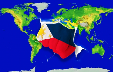 powerfull: Fist in color national flag of philippines punching world map as symbol of export, economic growth, power and success