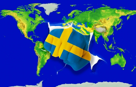 powerfull: Fist in color national flag of sweden punching world map as symbol of export, economic growth, power and success