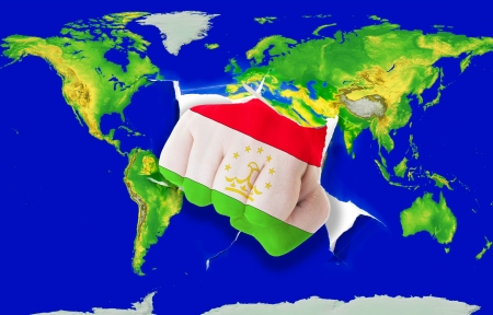 powerfull: Fist in color national flag of tajikistan punching world map as symbol of export, economic growth, power and success