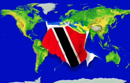 powerfull: Fist in color national flag of trinidad tobago punching world map as symbol of export, economic growth, power and success
