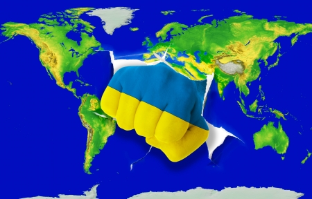 Fist in color national flag of ukraine punching world map as symbol of export, economic growth, power and success photo