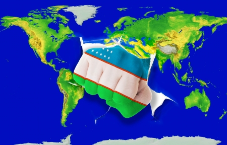 powerfull: Fist in color national flag of uzbekistan punching world map as symbol of export, economic growth, power and success